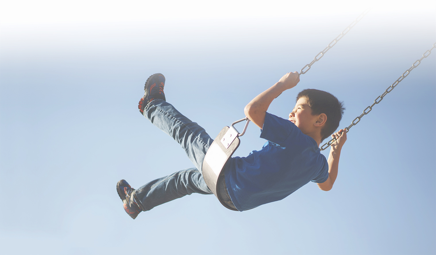 boy on a swing banner mobile